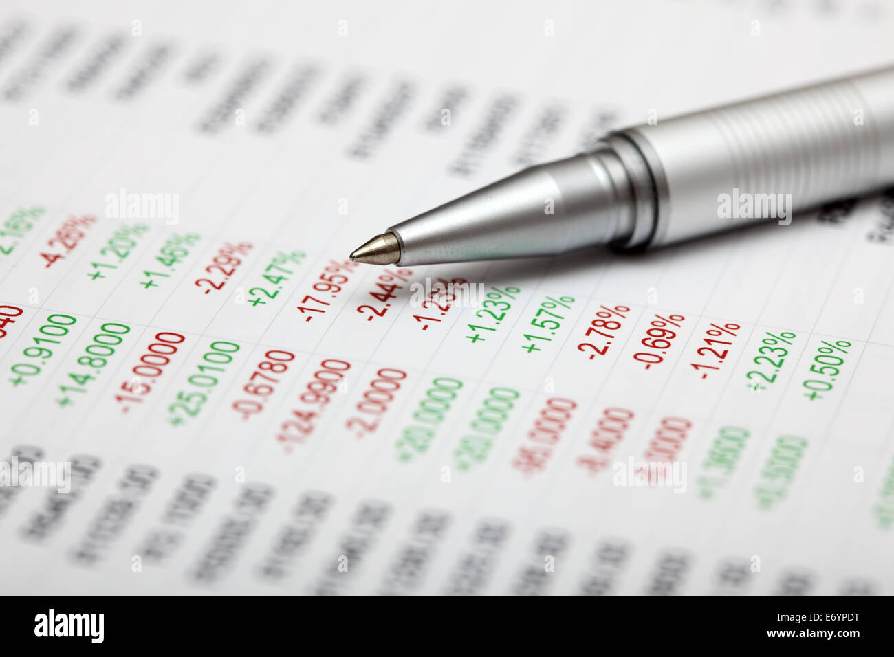 Analysis of financial statements. Focus on pen. Shallow depth of field. Closeup. - Stock Image