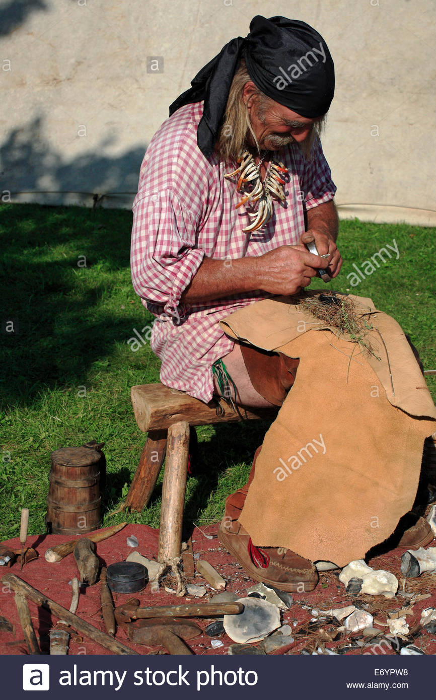 A member of the Ancient Ones of Maine demonstrating fire-starting at the annual Windsor Fair, Windsor, Maine, USA. - Stock Image