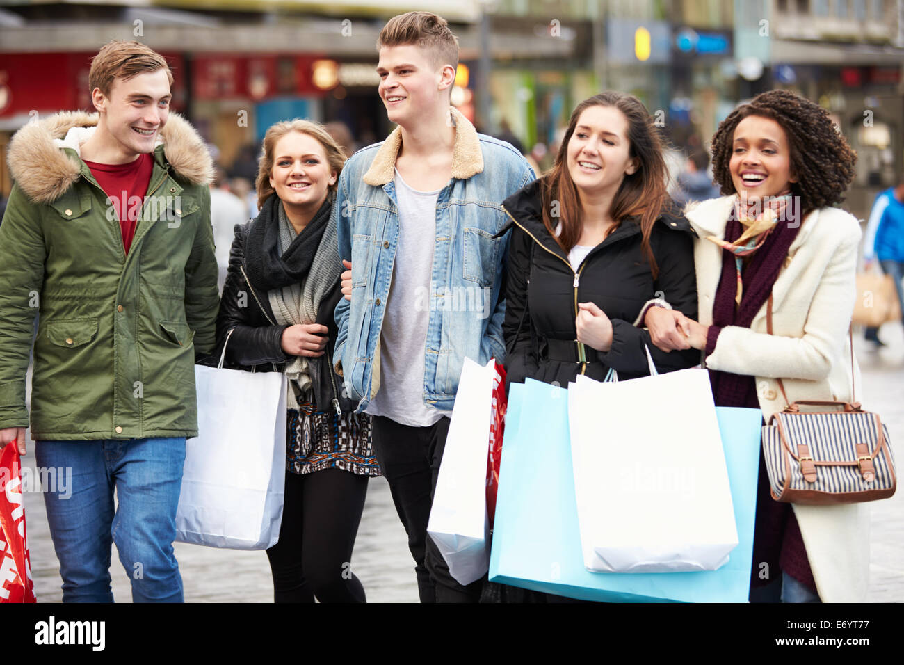Group Of Young Friends Shopping Outdoors Together - Stock Image