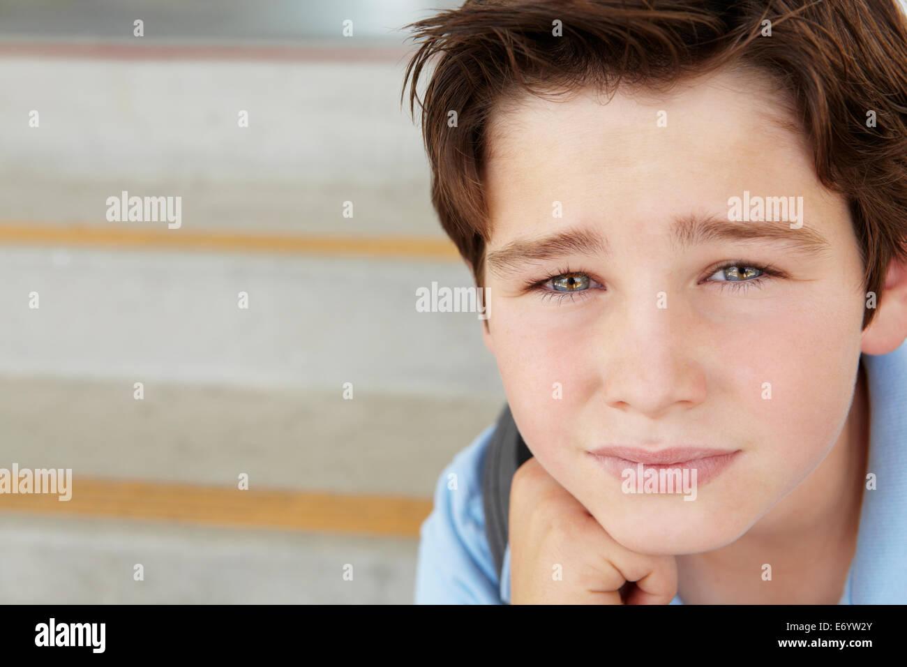 Unhappy Pre teen boy at school - Stock Image