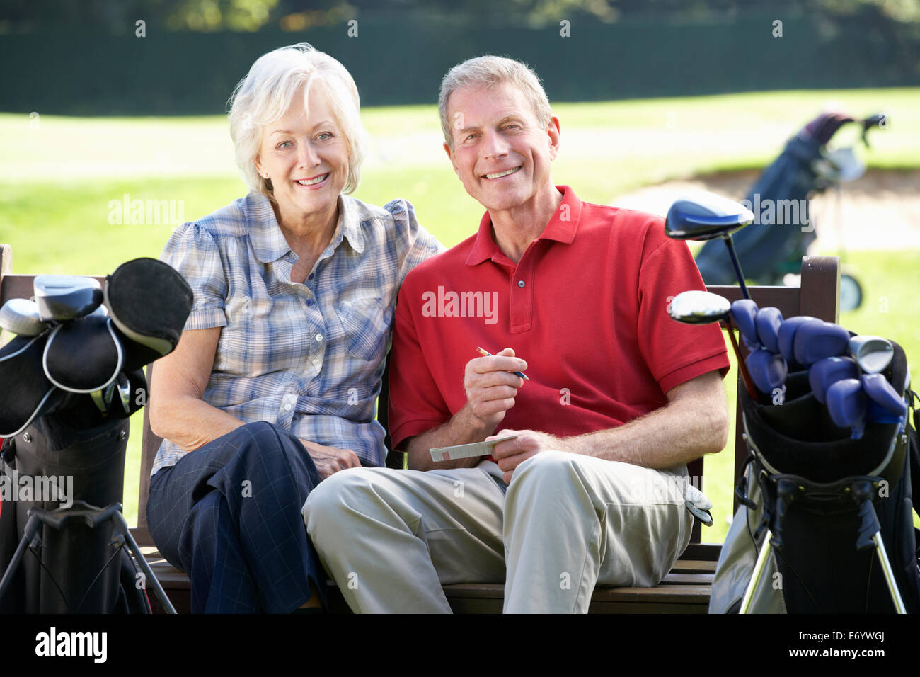 Senior couple on golf course - Stock Image