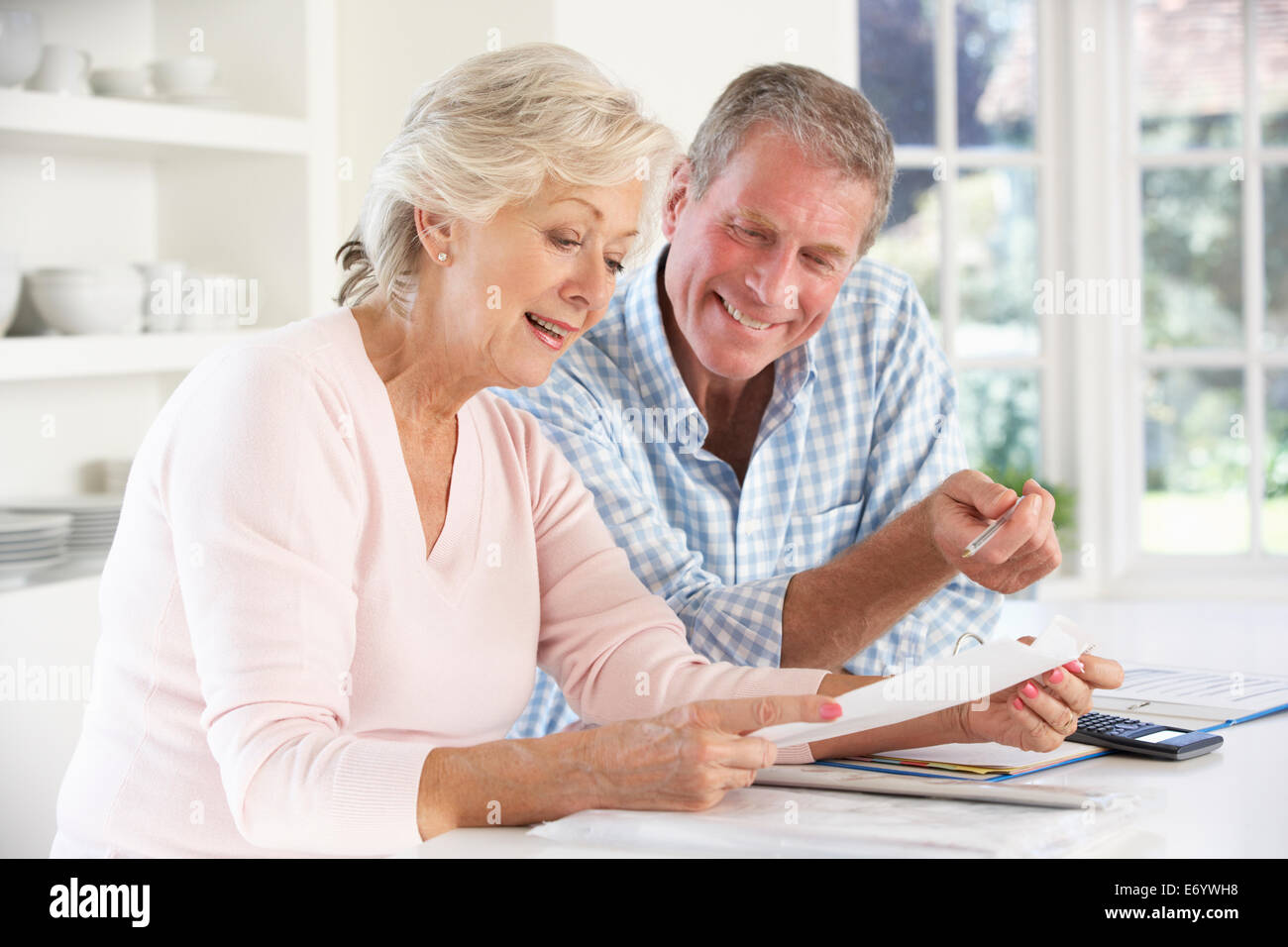 Retired couple with household bills - Stock Image