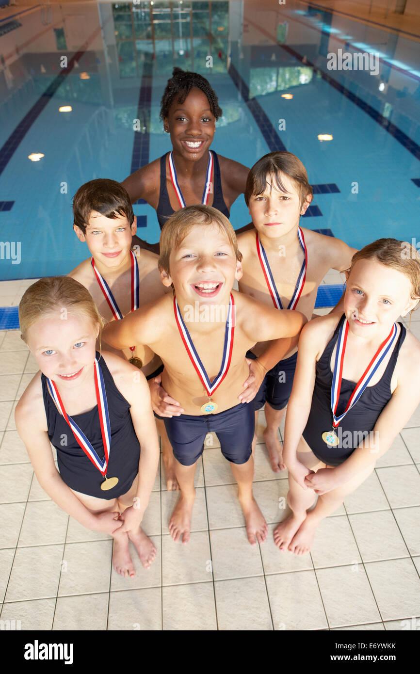 Winning swimming team - Stock Image