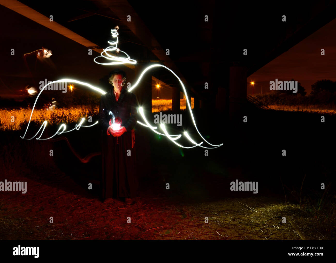 A Surreal Angel, Created with light painting, the wings and halo in, no flash a lantern and bike lights to create - Stock Image