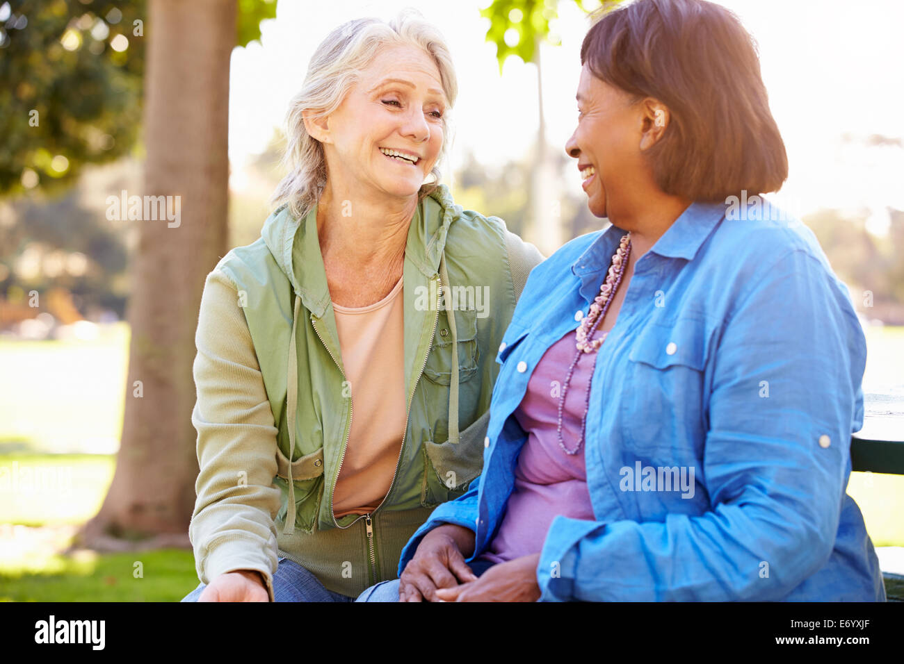 Two Senior Women Talking Outdoors Together - Stock Image