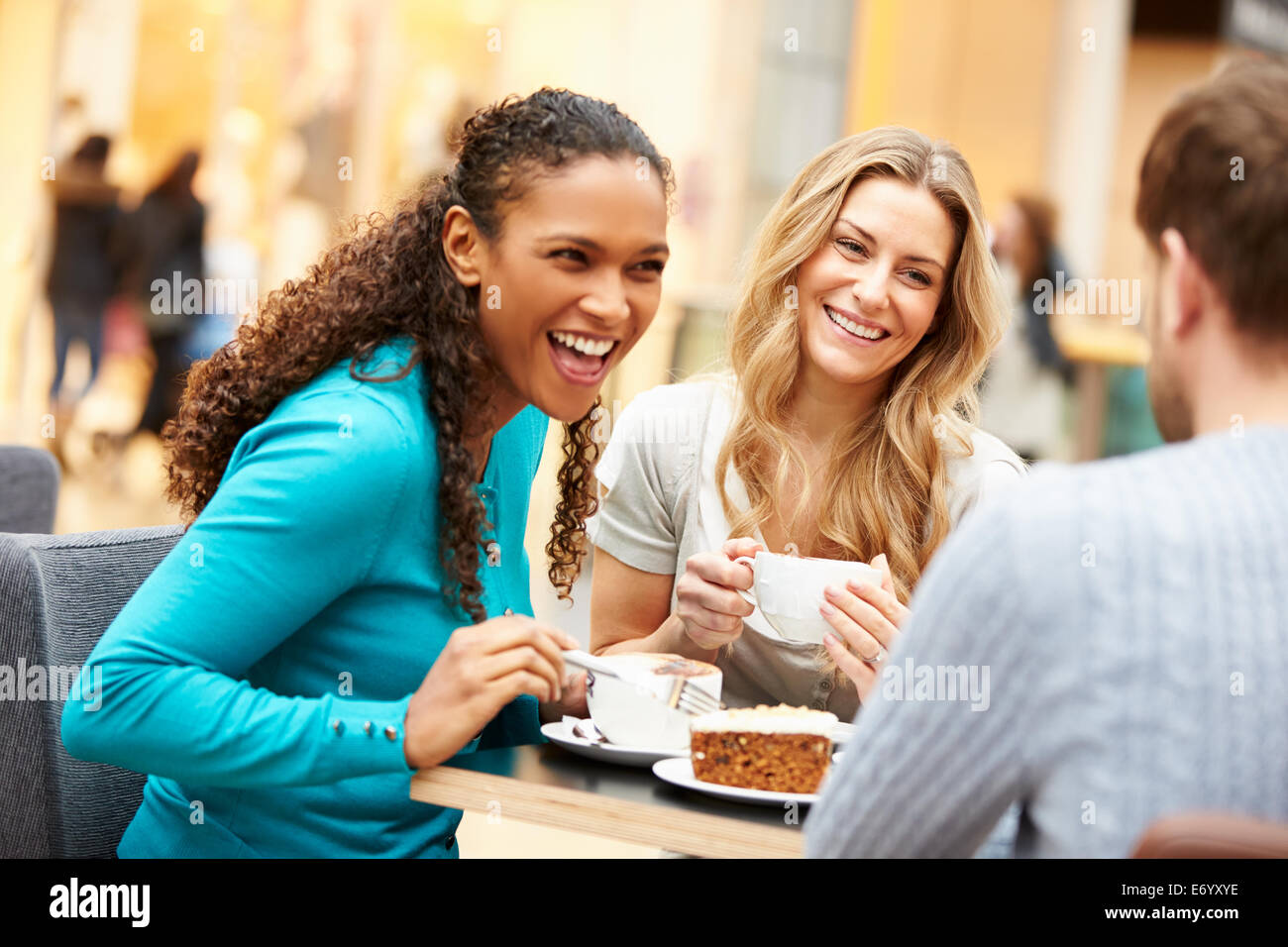 Group Of Young Friends Meeting In Café Stock Photo