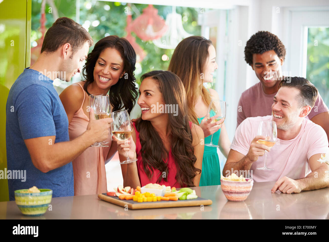 Group Of Friends Enjoying Drinks Party At Home - Stock Image