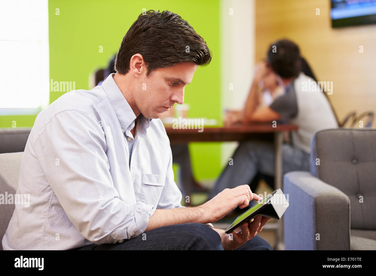 Man Taking A Break Working In Design Studio - Stock Image