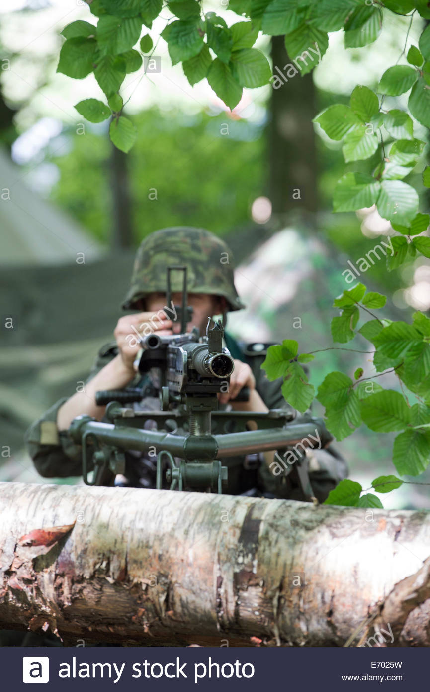WW2 German army soldier with machine gun in woods. Historical re enactment at Military Odyssey, Detling, Kent, UK - Stock Image