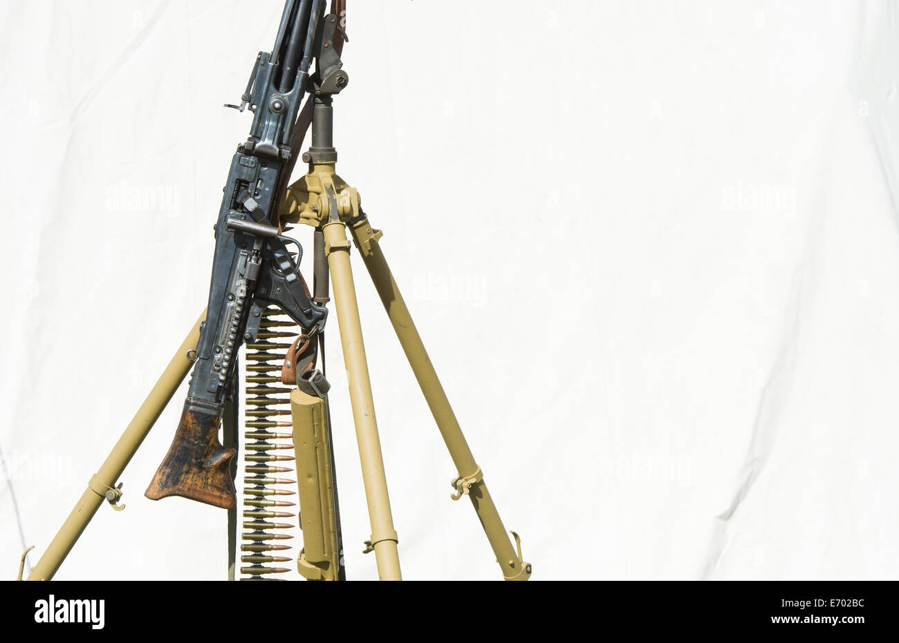 WW2 German army MG 42 machine gun with bullet belt. Historical re enactment at Military Odyssey, Detling, Kent, - Stock Image