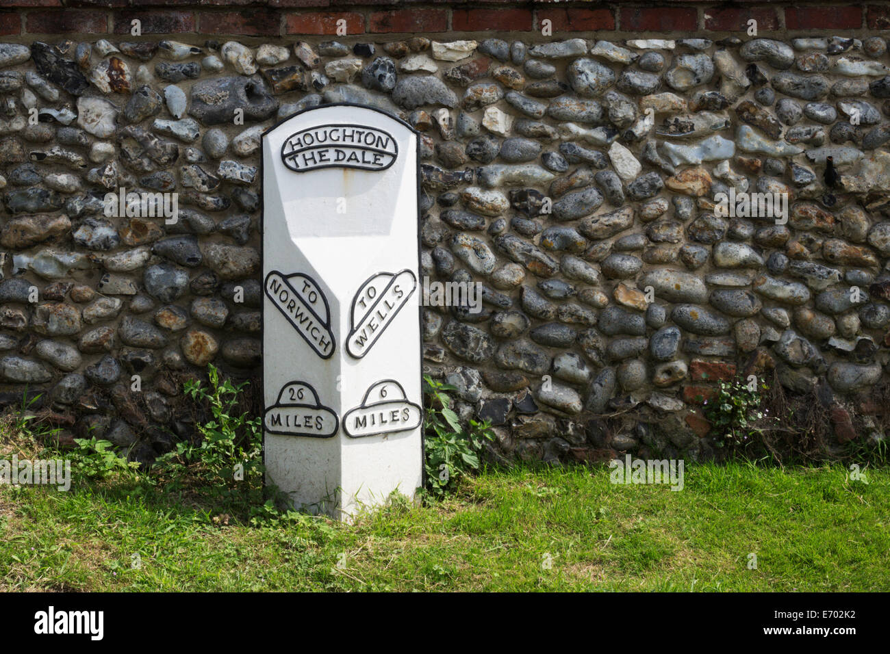 Old milestone at Houghton the Dale, in Norfolk, England. - Stock Image