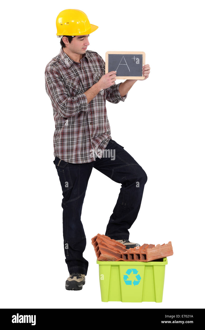 Builder rating his recycling efforts - Stock Image
