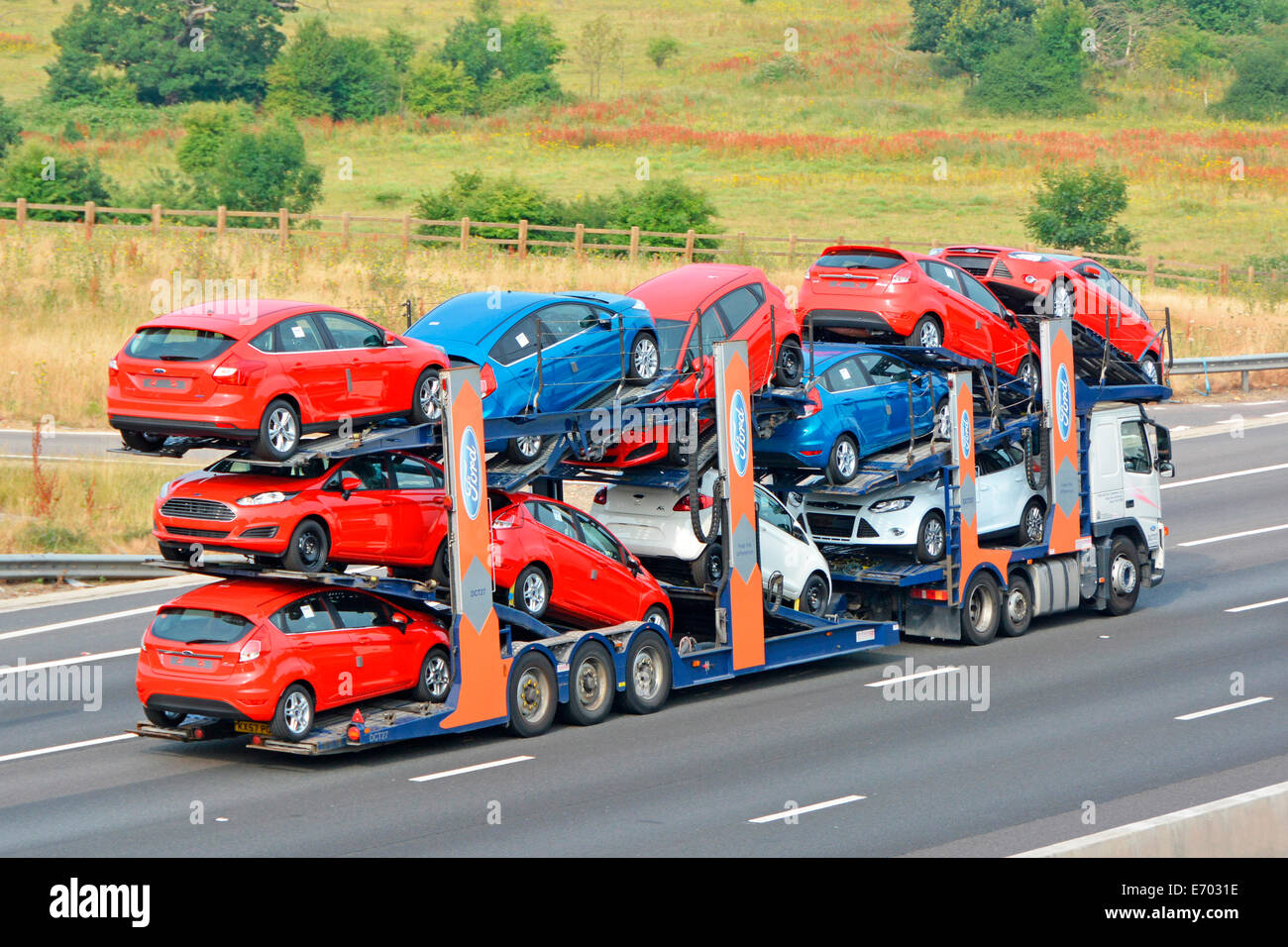 Ford Car Transporter And Trailer Loaded With Eleven New Red White And Blue Vehicles Stock