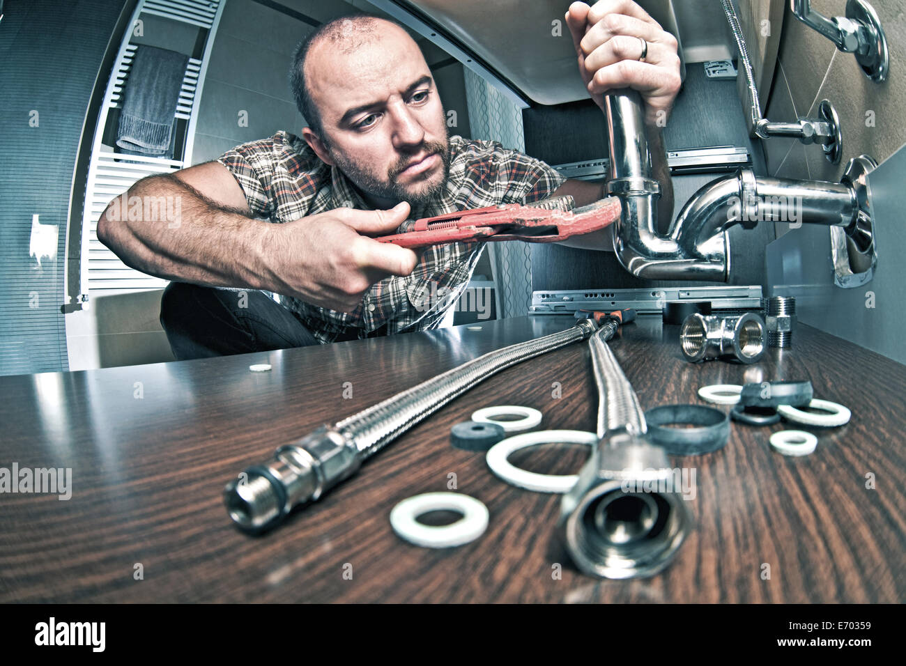 portrait of plumber at work - Stock Image