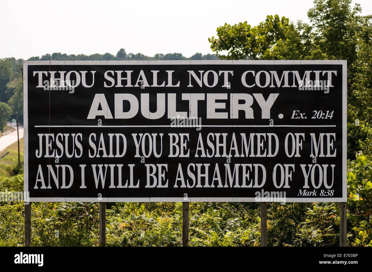 Thou Shall Not Commit Adultery road sign in Kentucky - Stock Image