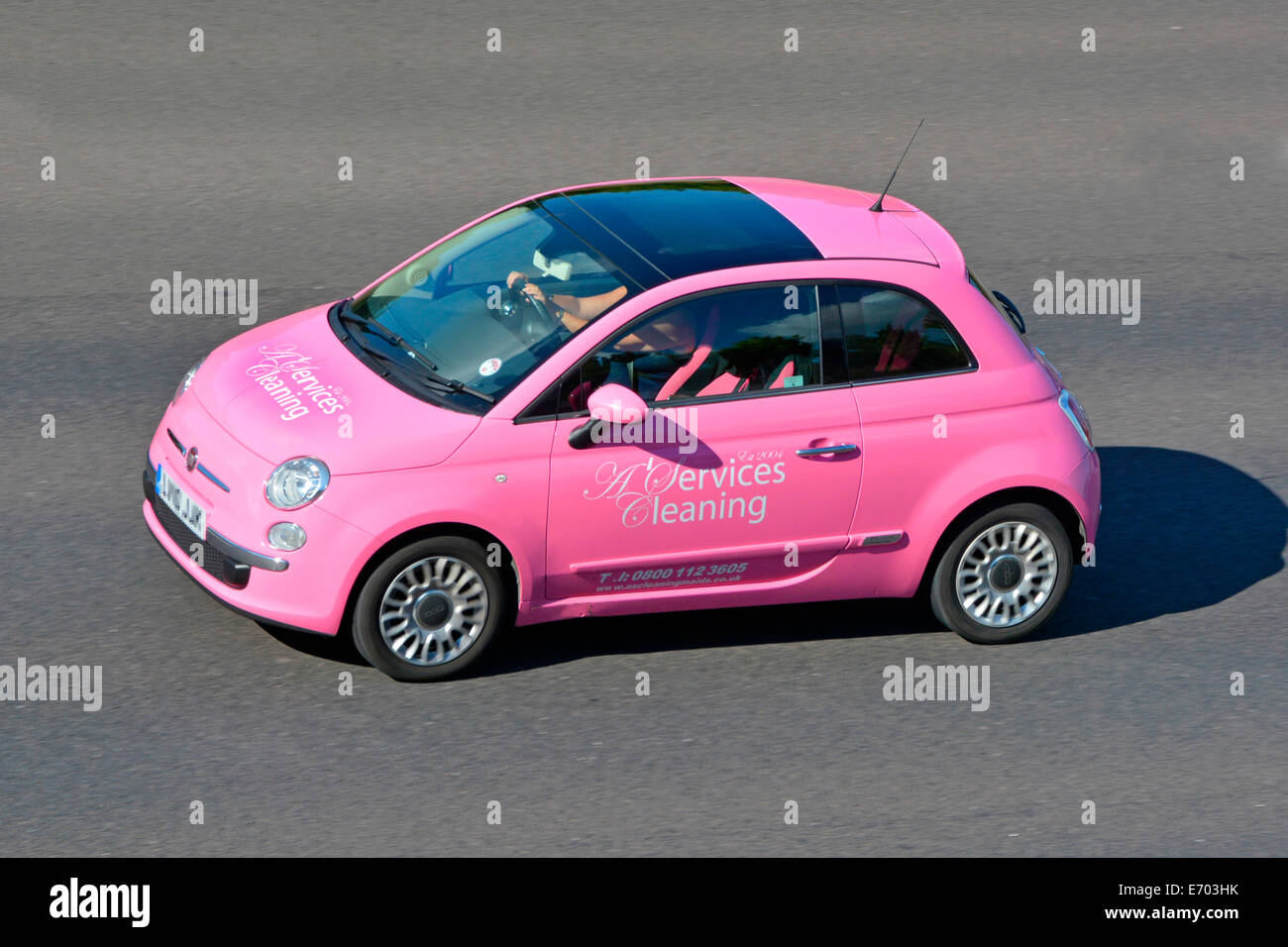 Pink Fiat car with advertising for cleaning services - Stock Image