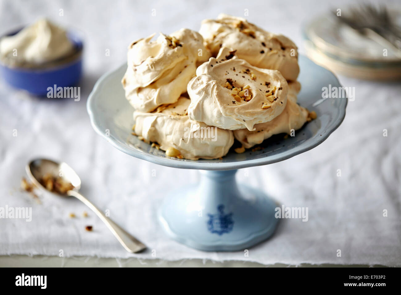 Hazelnut meringue on desert plate - Stock Image