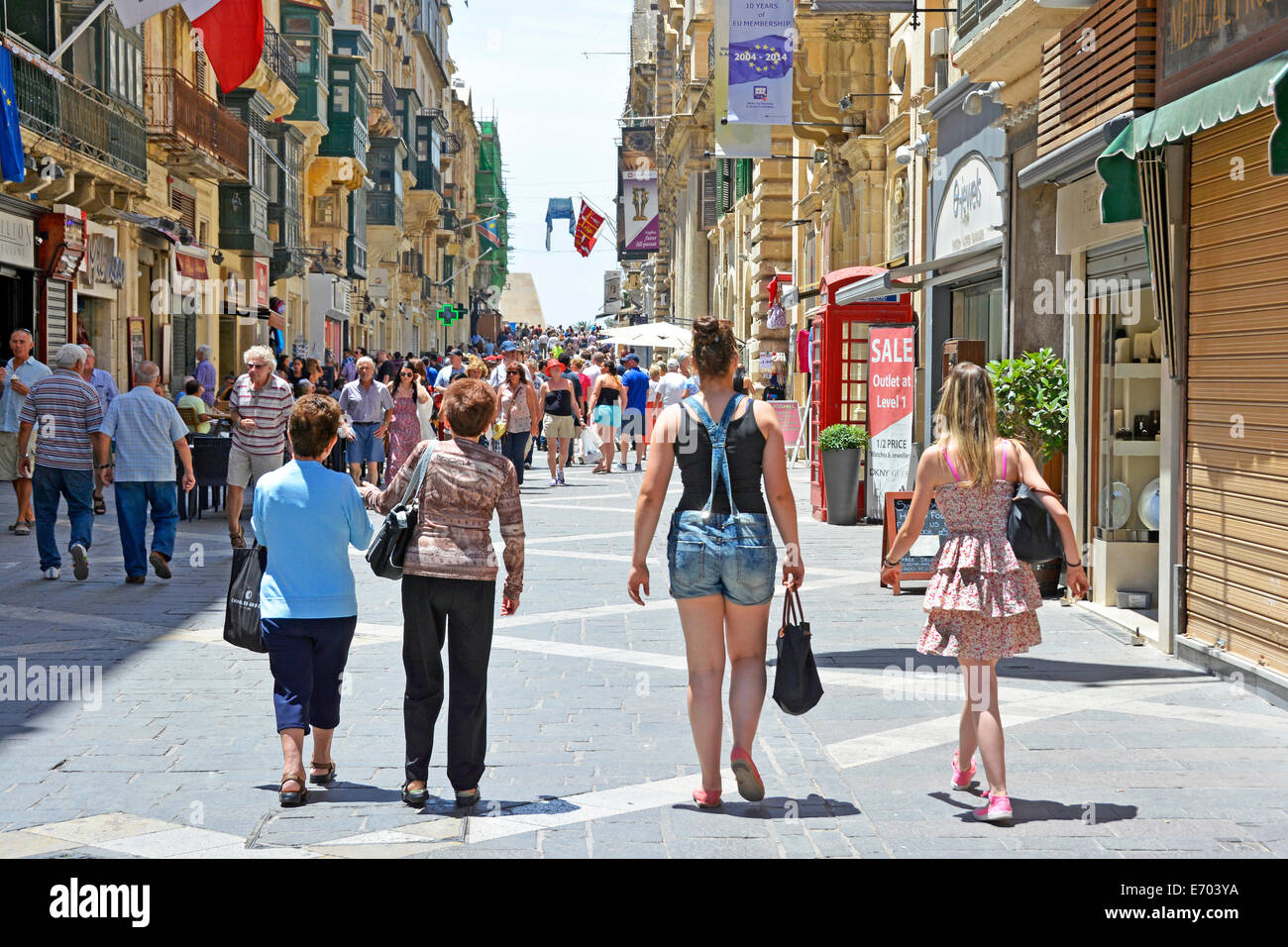 Shoppers and tourists in pedestrianised Republic Street Valletta - Stock Image