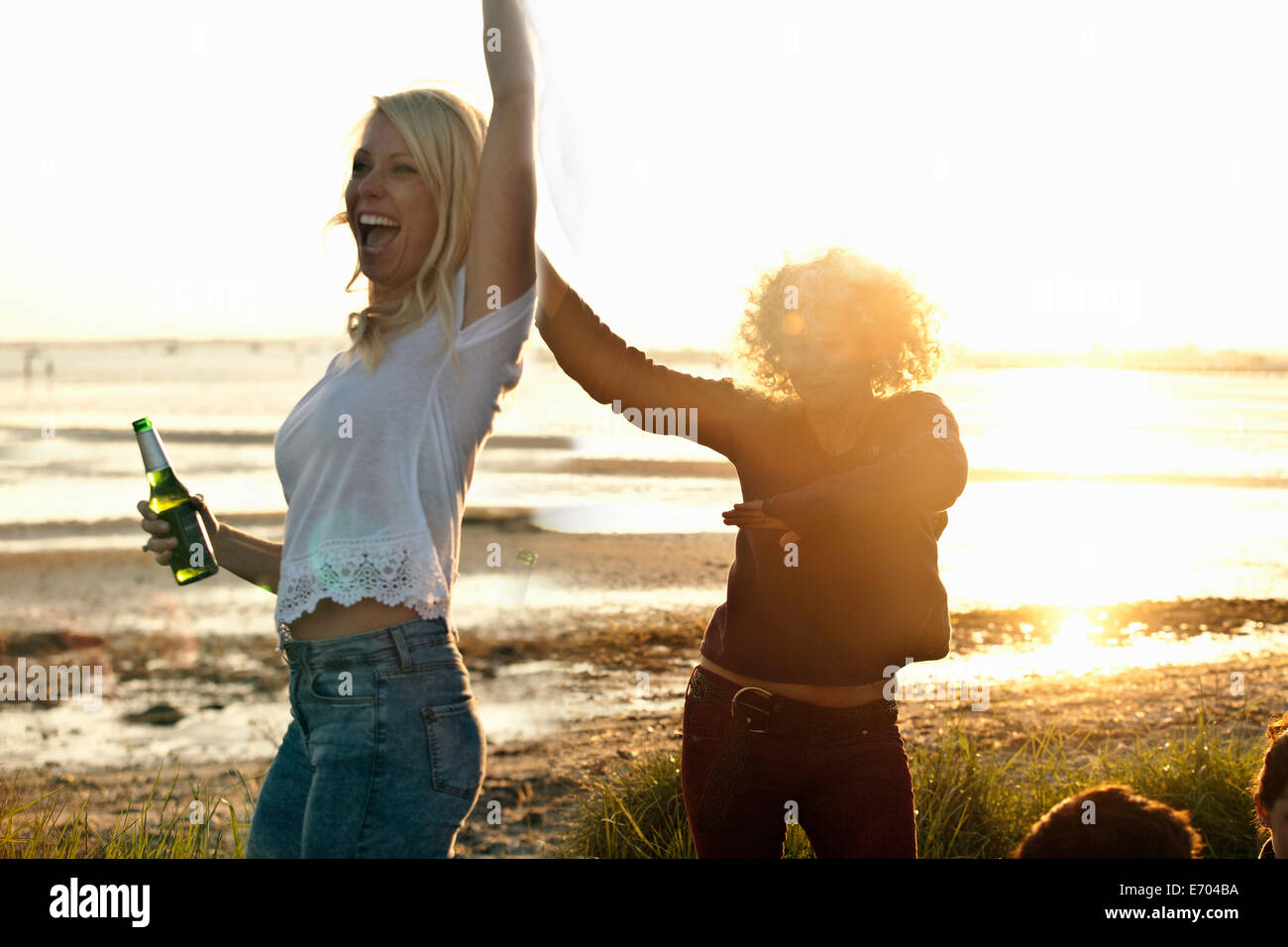 Mother and daughter partying on Bournemouth beach, Dorset, UK - Stock Image