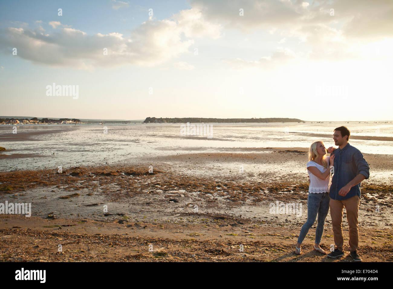 Young couple enjoying beach Stock Photo