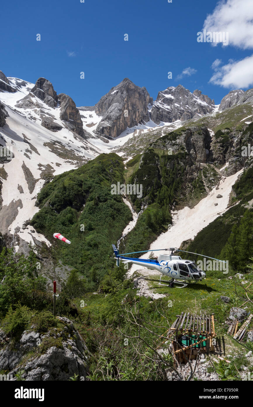 Helicopter on scenic flight, Alleghe, Dolomites, Italy - Stock Image