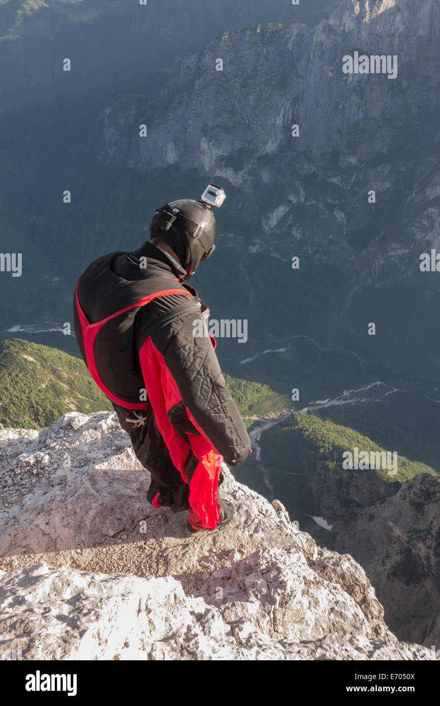 BASE jumper on mountain edge, Alleghe, Dolomites, Italy - Stock Image