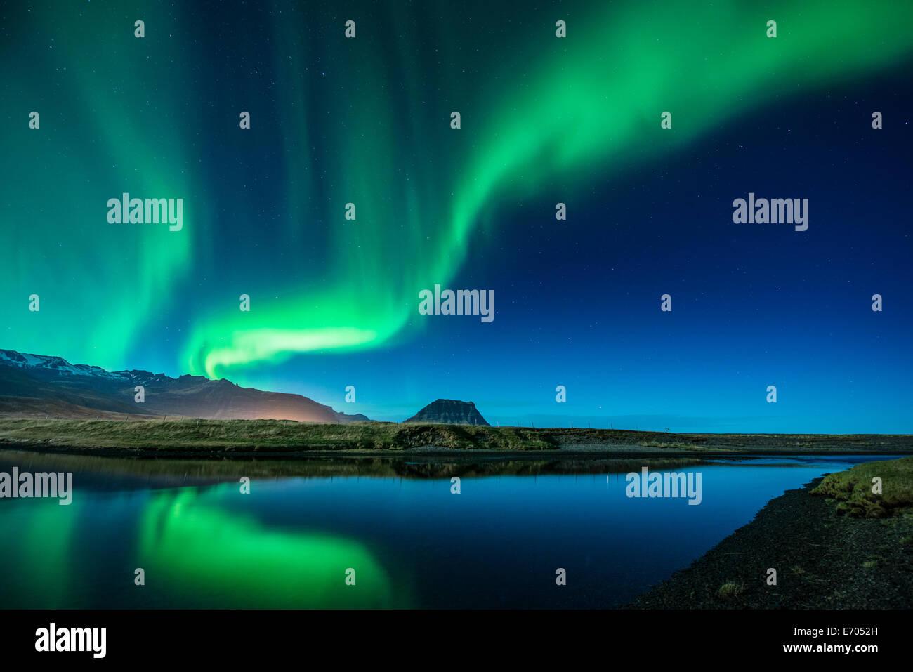 Aurora Borealis above Grundarfjordur, Mt. Kikjufell in centre, Snaefellsnes, Iceland - Stock Image