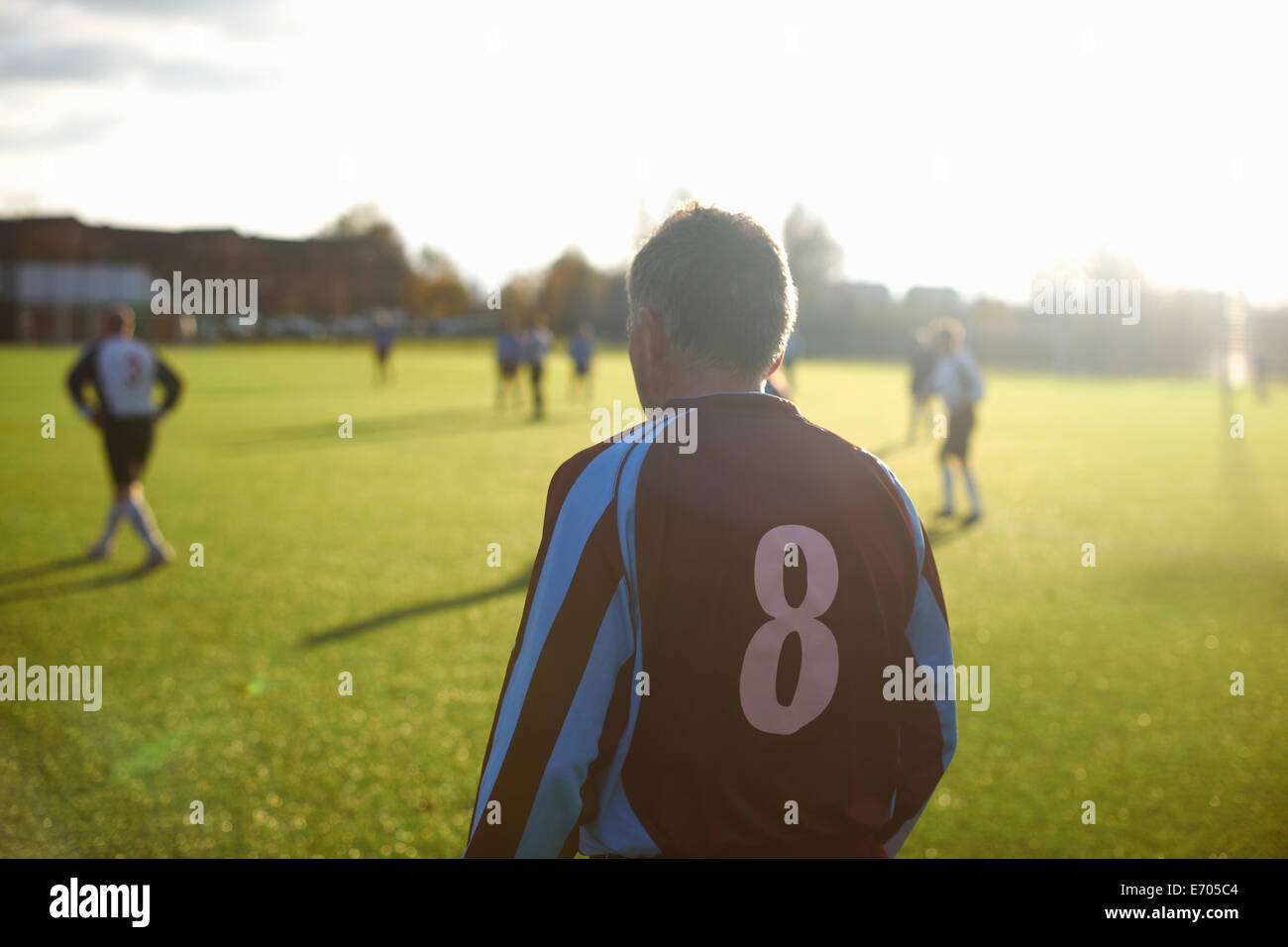 Rearview of football player number 8 - Stock Image