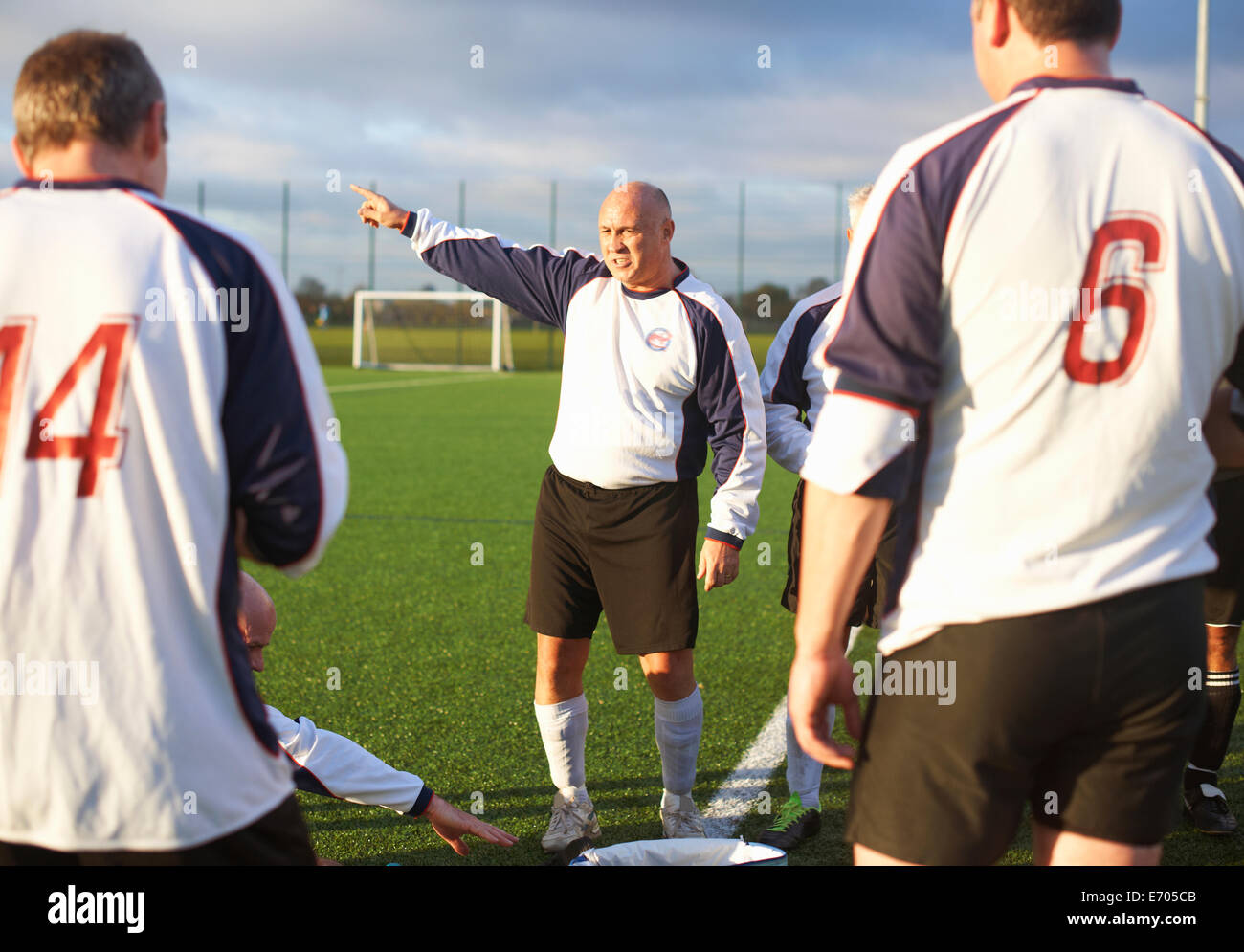 Football players resting at half time - Stock Image