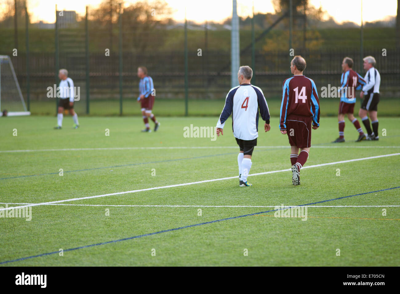 Football players at stop in game - Stock Image