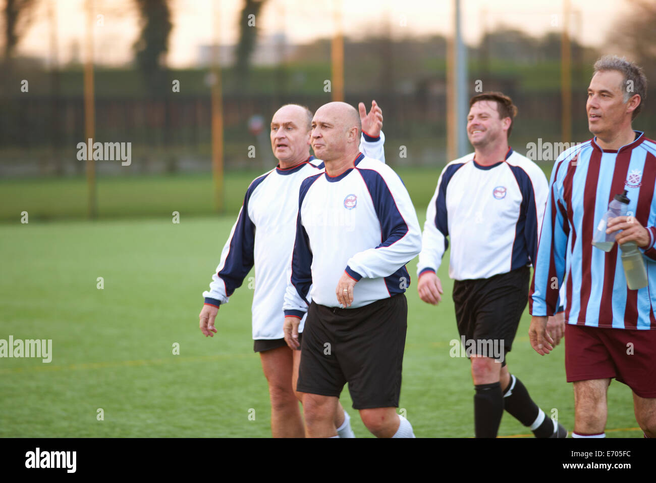 Football players at end of game - Stock Image