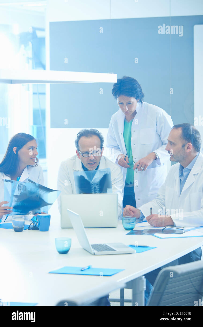 Group of doctors looking at x-rays - Stock Image