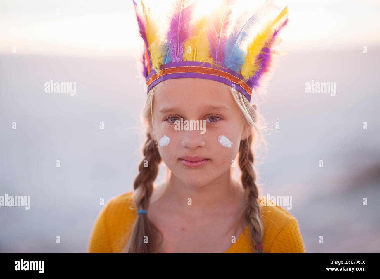 Portrait of girl dressed as native american with feather headdress Stock Photo