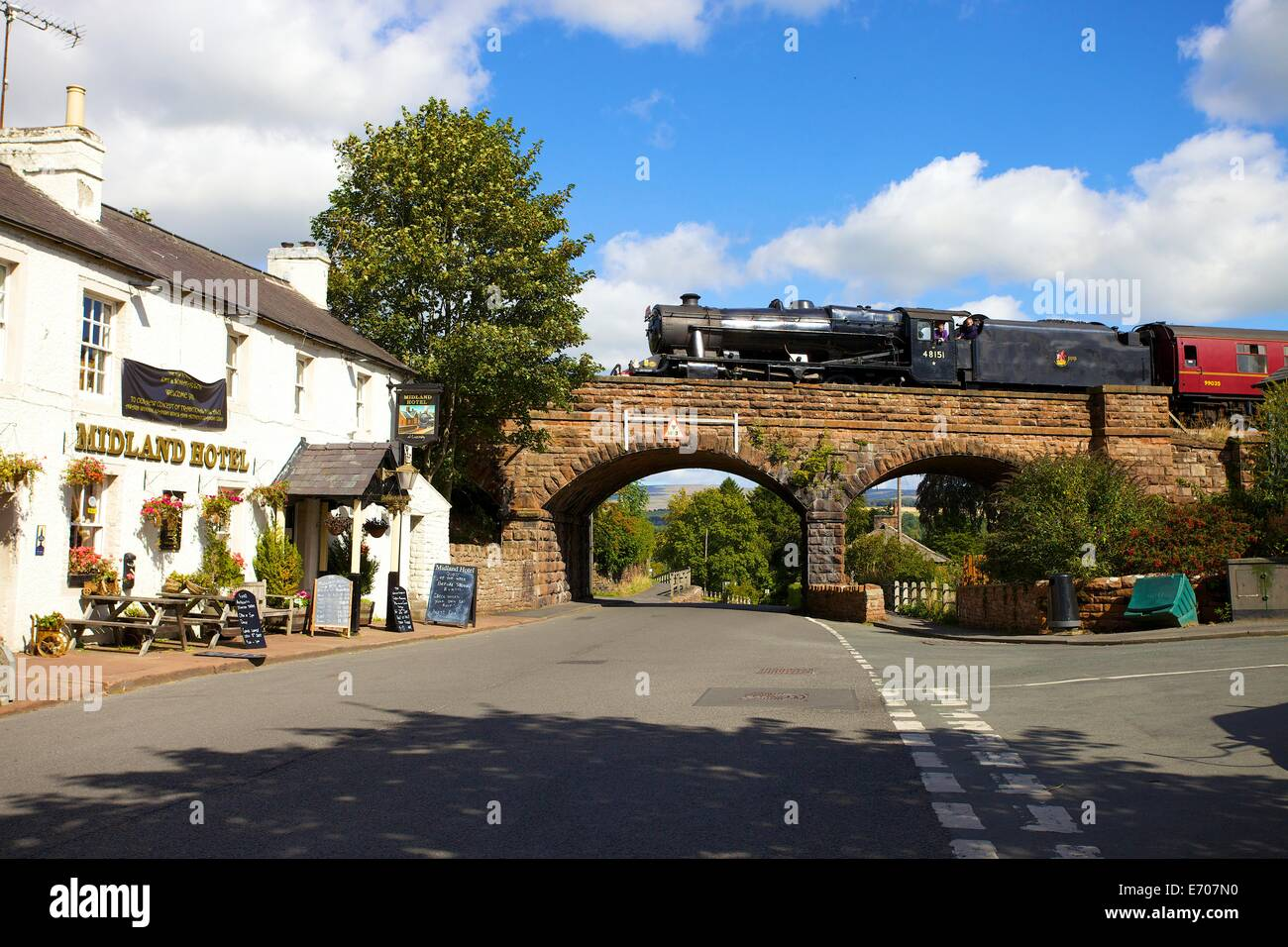 Steam train the LMS Stanier Class 8F 48151, on the bridge in Lazonby, Eden Valley, Cumbria, England, UK. - Stock Image
