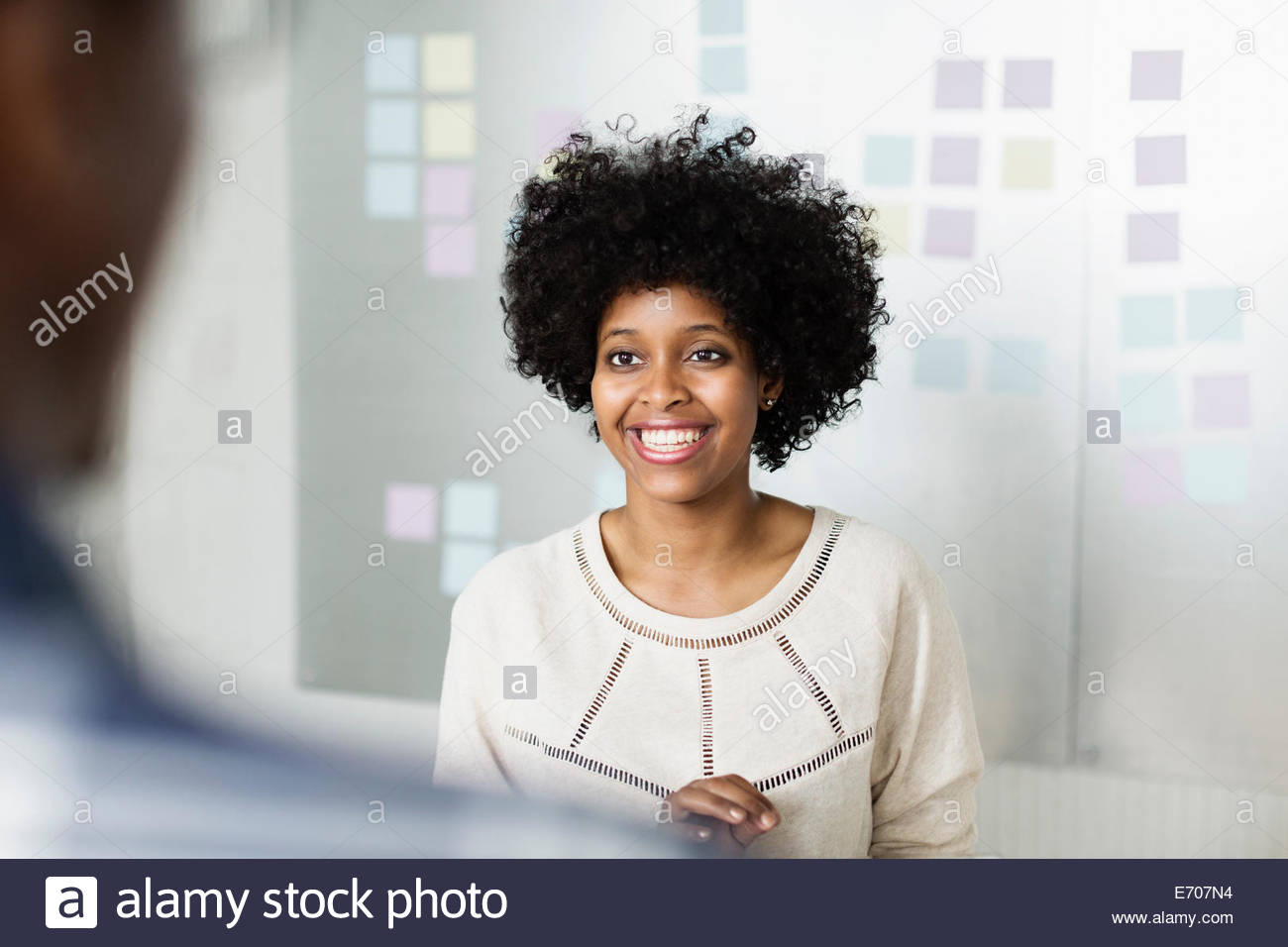 Portrait of young woman smiling - Stock Image