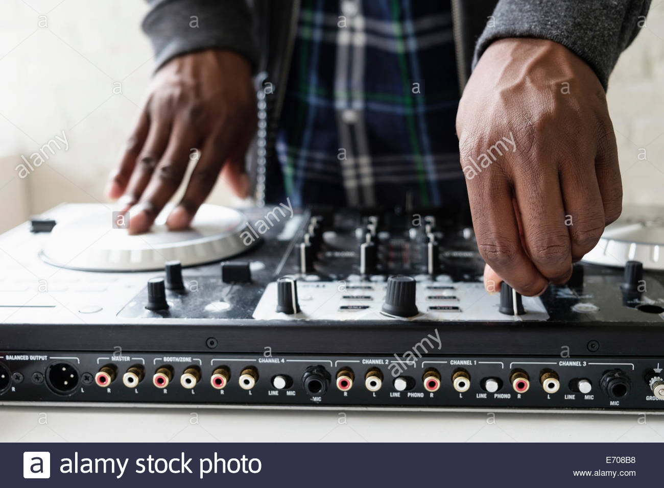 DJ using mixing desk, close up - Stock Image