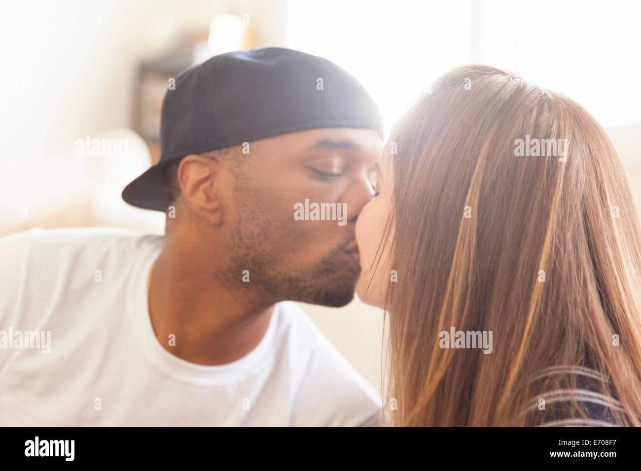 Mid adult couple kissing - Stock Image