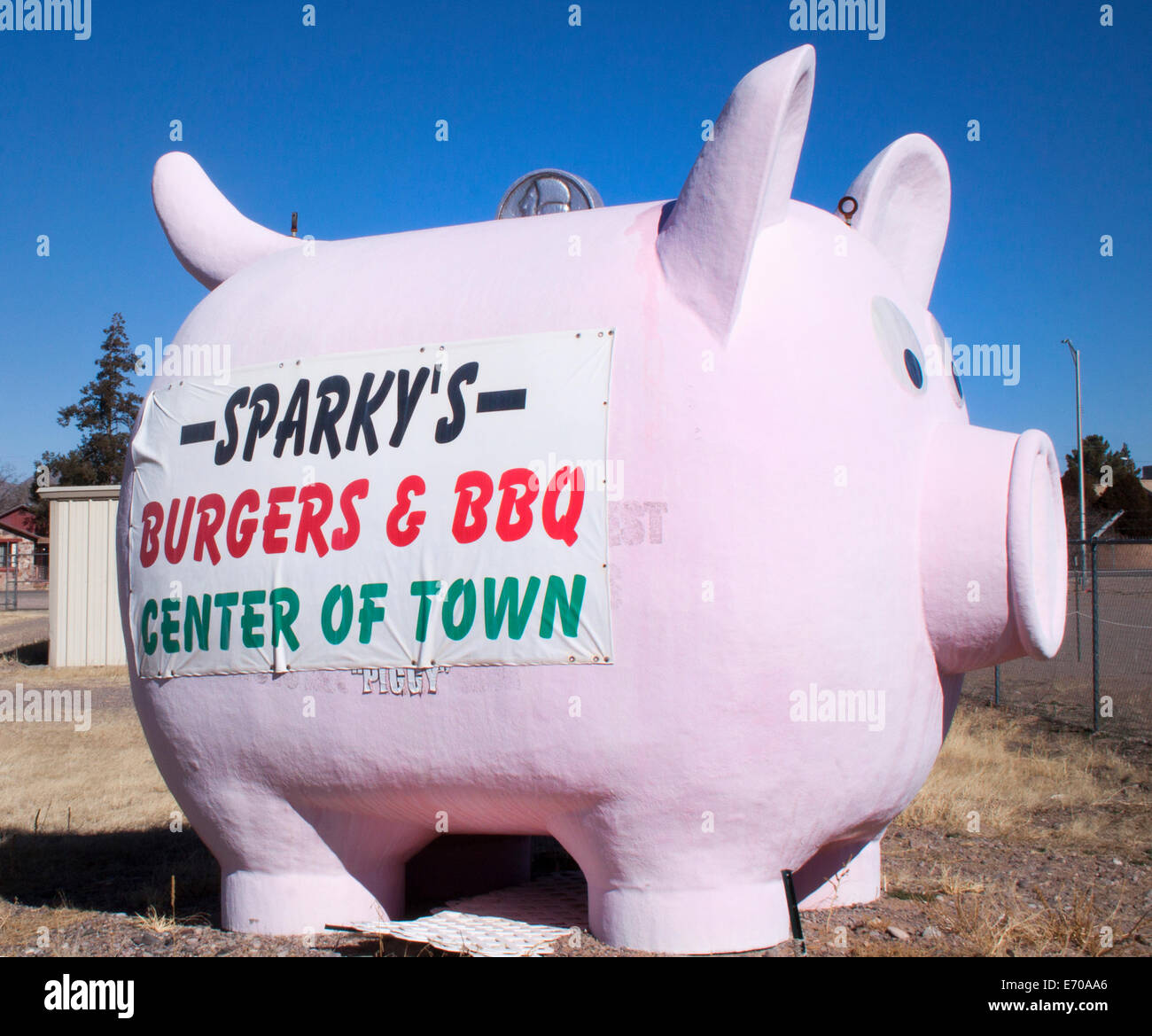 Giant Piggy Bank advertising a restaurant in Hatch New Mexico - Stock Image