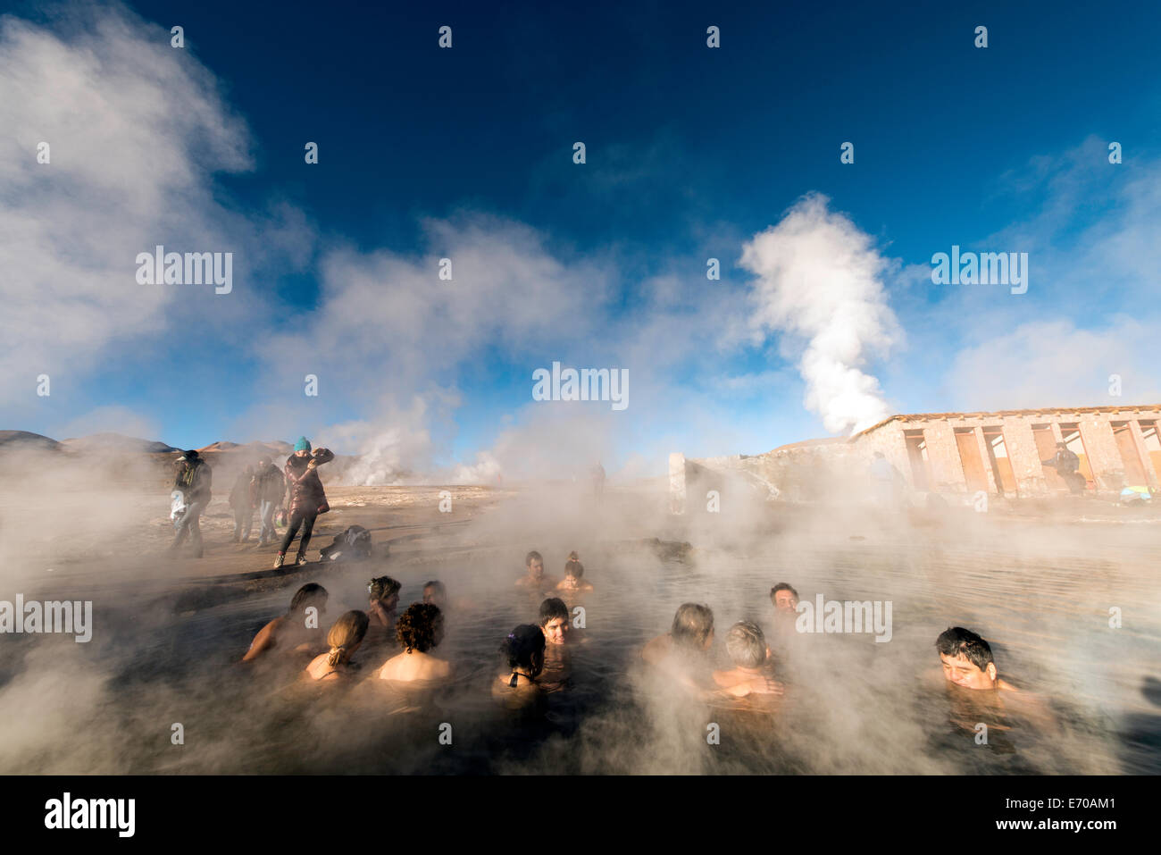 People bathing at Tatio Geysers Geothermal fields San Pedro de Atacama Chile South America - Stock Image