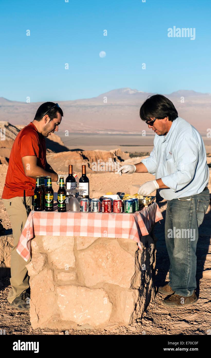 Tourist guides preparing refreshments at Moon Valley San Pedro de Atacama, Chile, South America - Stock Image