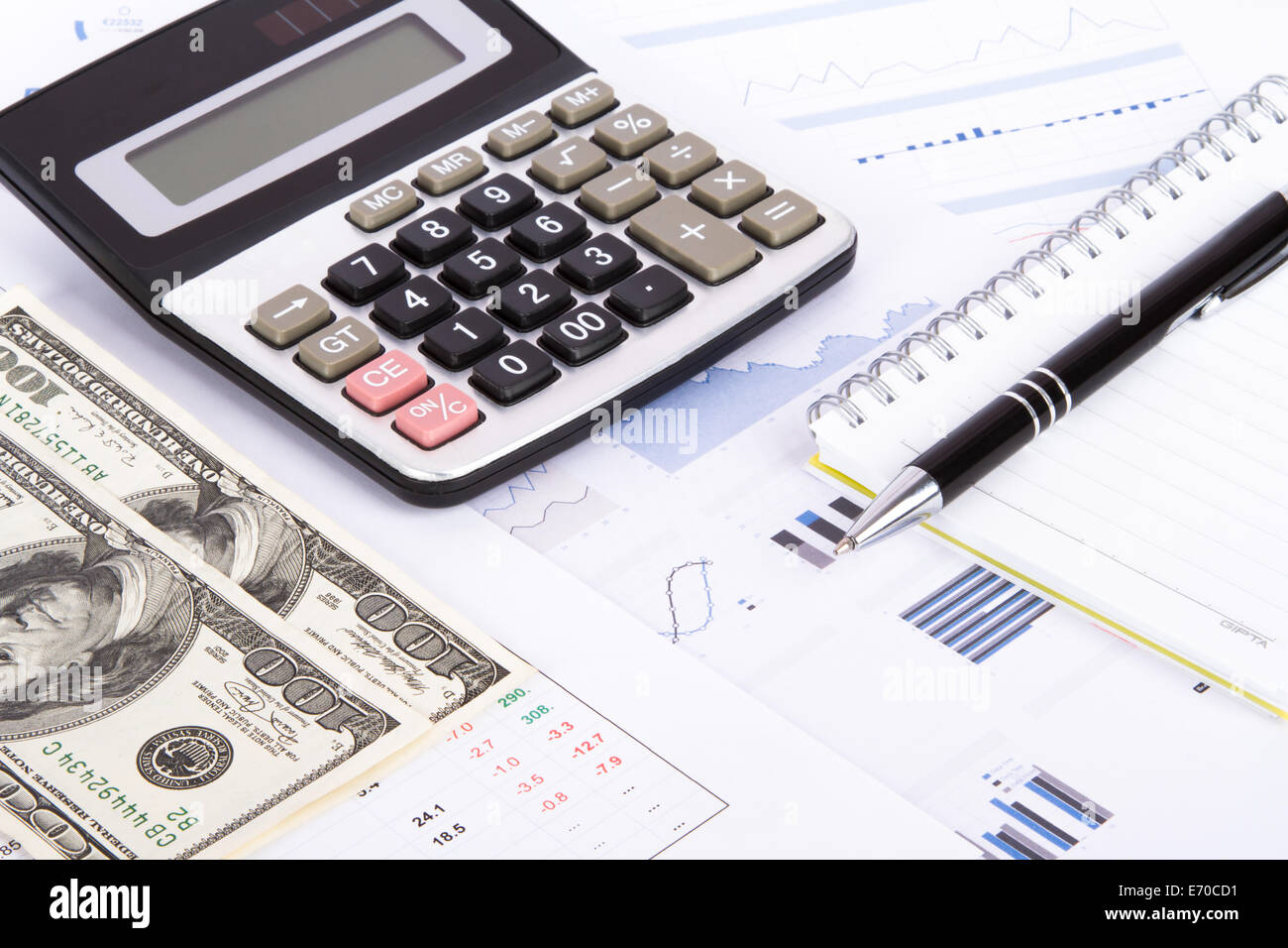 Finance concept, financial and stock market graphs, charts analysis on business table for earning money. - Stock Image
