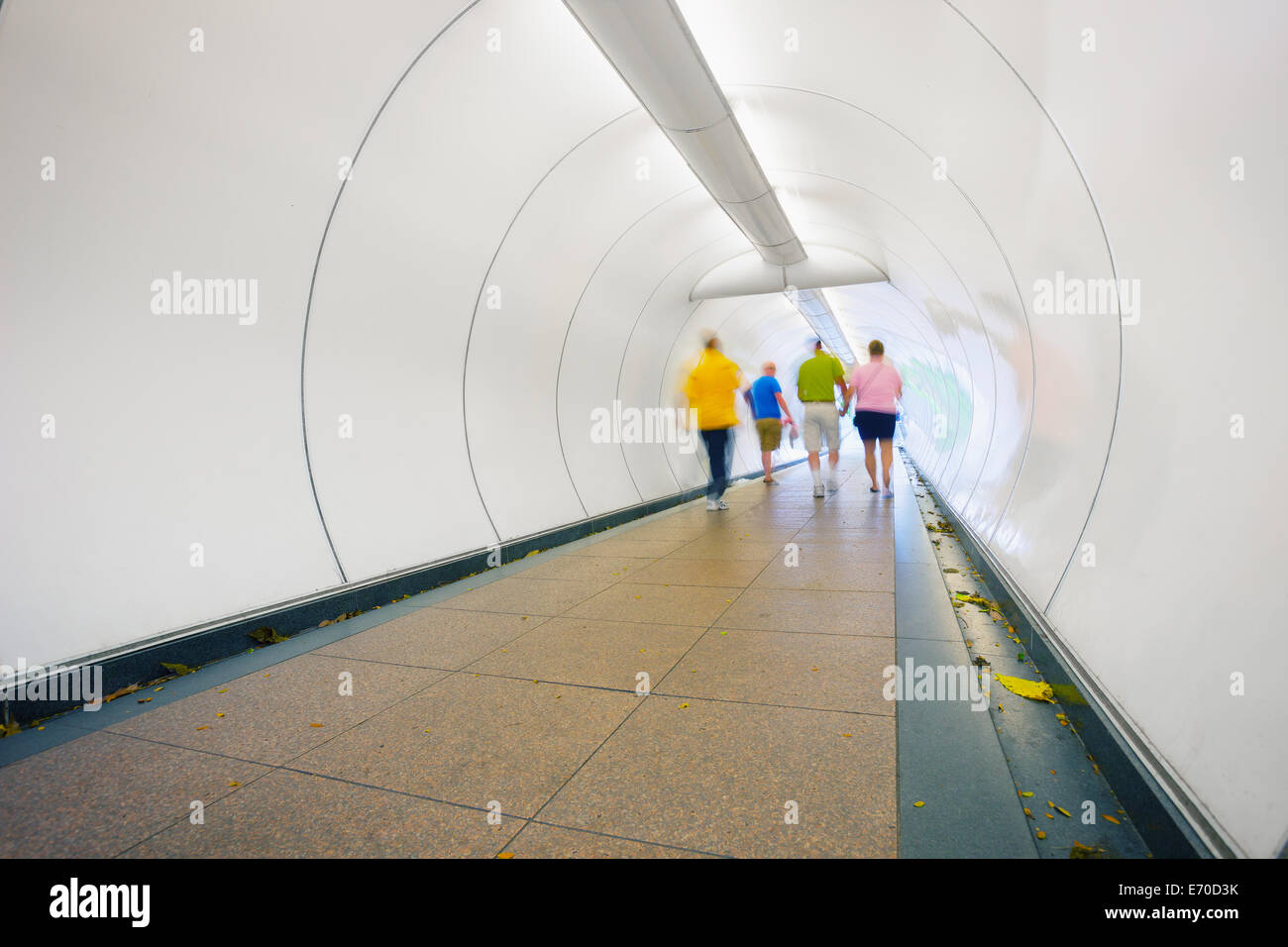 People go through the underpass. Abstract photo from the center of Singapore - Stock Image