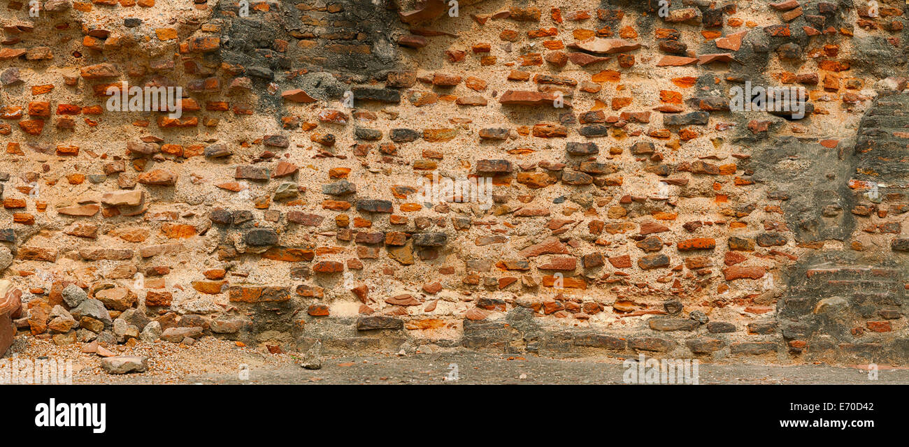 Very old red brick wall. India, Agra. Panoramic photo - Stock Image