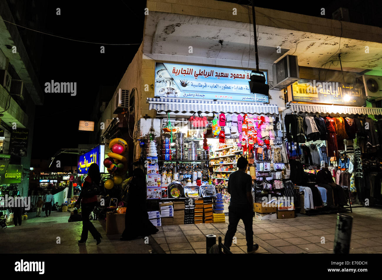 Aqaba is Jordan's only coastal city. Shopping street at night. - Stock Image