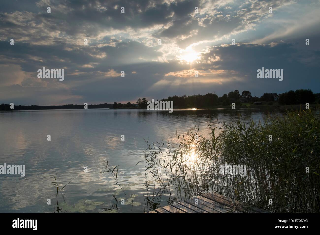 scenic lake view Poland water summer sky drama - Stock Image