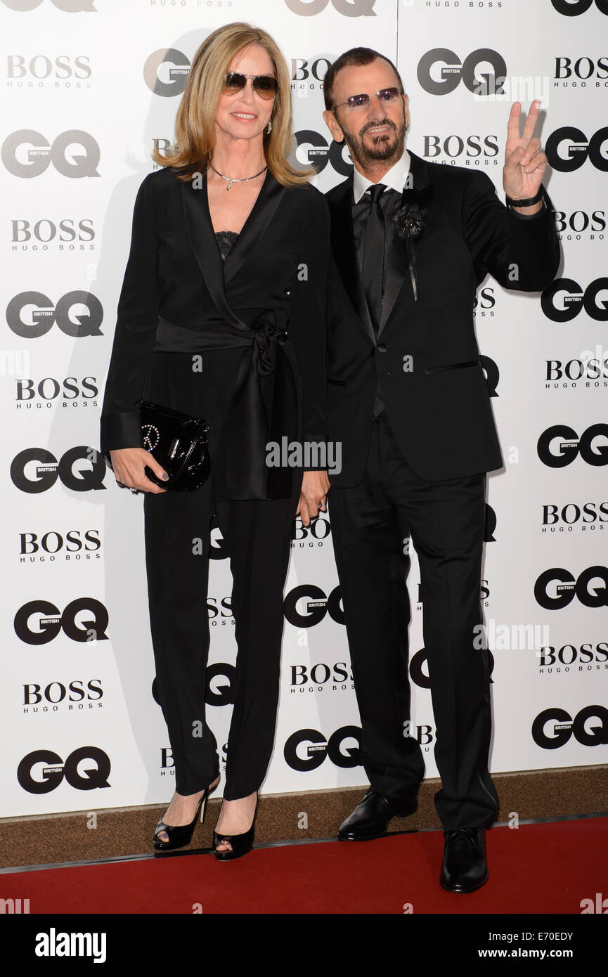 Barbara Bach and Ringo Starr arrive for the GQ Men Of The Year Awards 2014. - Stock Image