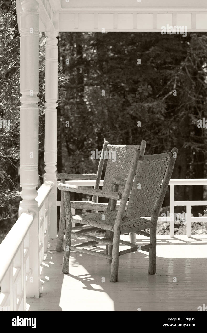 old chairs on front porch - Stock Image