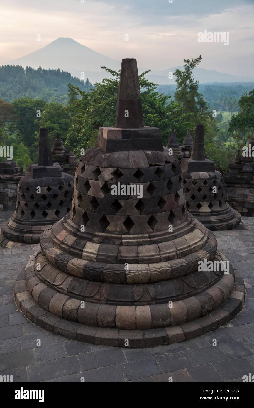 Borobudur, Java, Indonesia.  Stupas and Mount Merapi in Early-morning Haze. - Stock Image