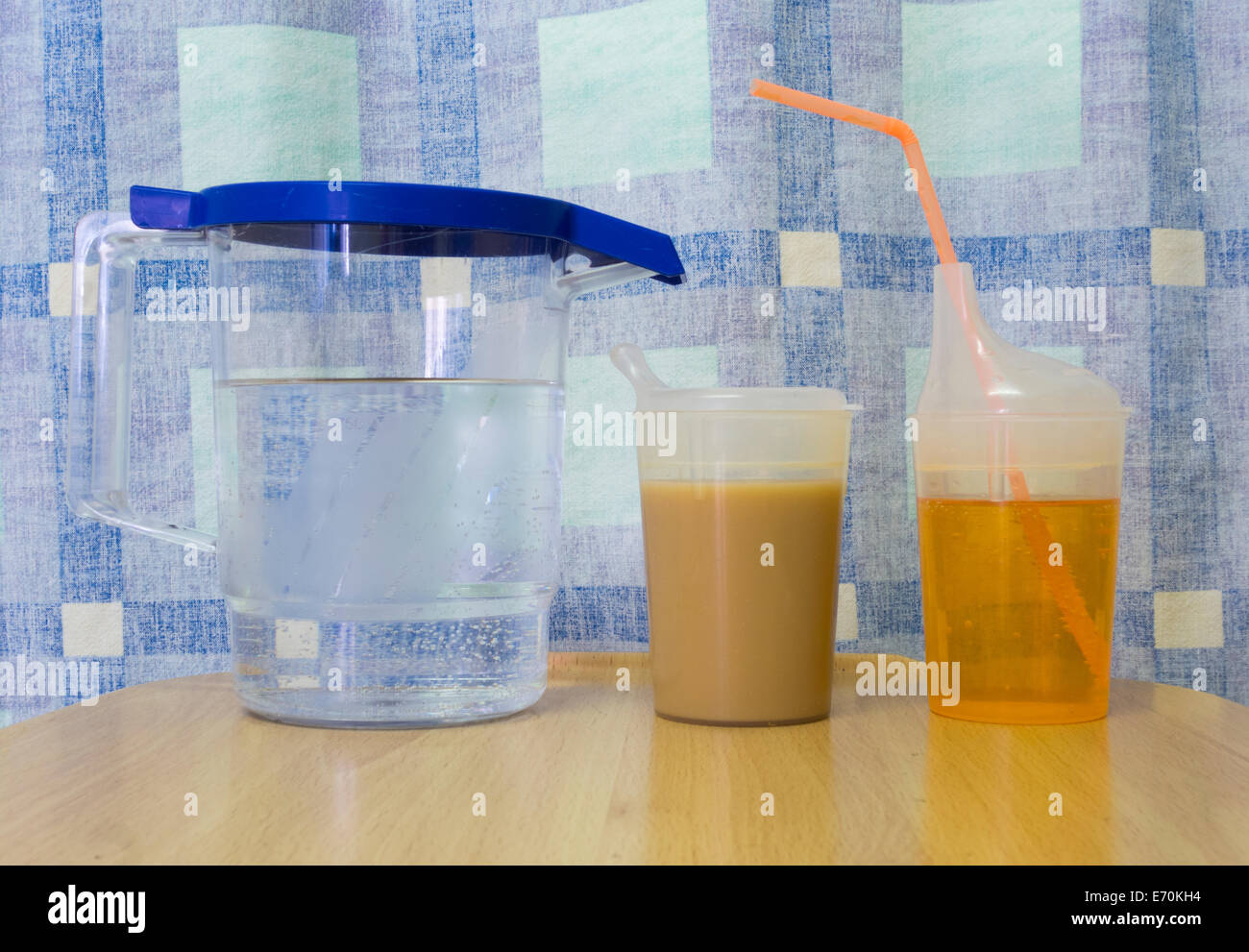 Jug of water, tea and juice drink on patients table in NHS hospital. England. UK - Stock Image