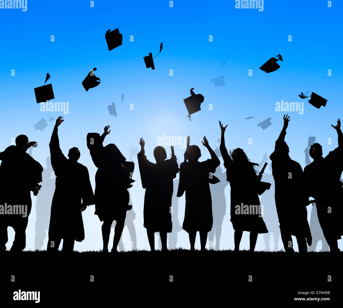 Group Of Diverse International Students Celebrating Graduation - Stock Image